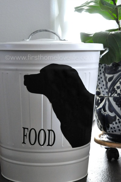 Create your own pet food storage containers with an #IKEA trashcan and #Silhouette machine! Perfect storage solution for your #pets via www.firsthomelovelife.com