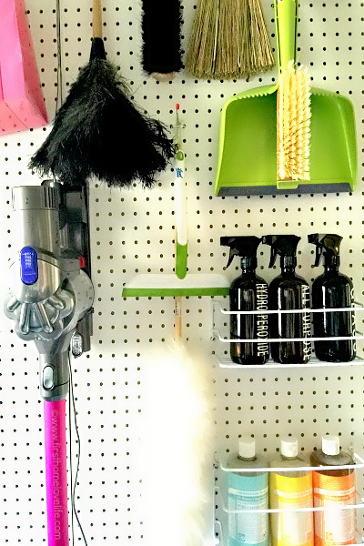cleaning supply storage on pegboard via www.firsthomelovelife.com