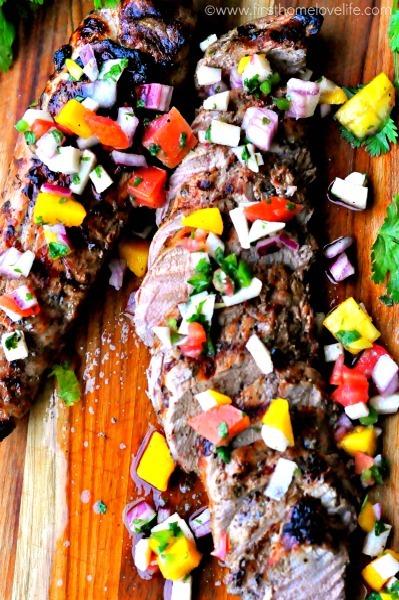 grilled pork tenderloin marinated in Mojo, and topped with mango salsa via firsthomelovelife.com