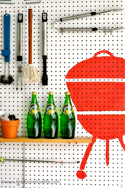 painted grill on pegboard for grilling station
