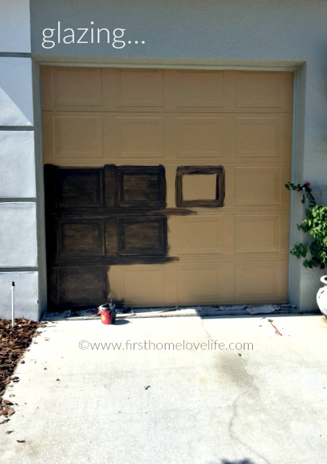 glazing the garage to make it look like wood via www.firsthomelovelife.com