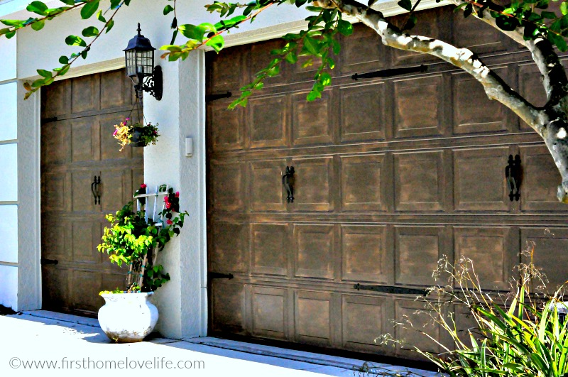 wood painted garage doors via firsthomelovelife.com