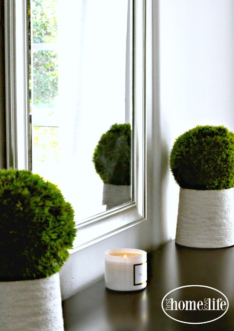 moss balls and white candle via firsthomelovelife.com