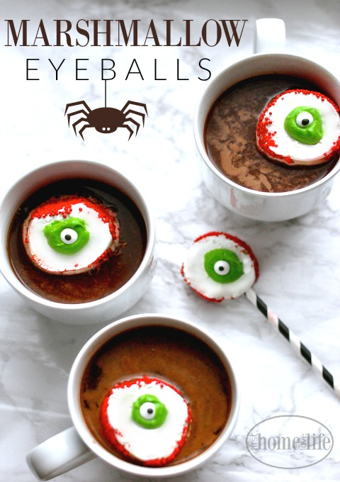 Halloween Hot Chocolate with Marshmallow Eyeballs. Perfect treat for kids this Halloween! via firsthomelovelife.com
