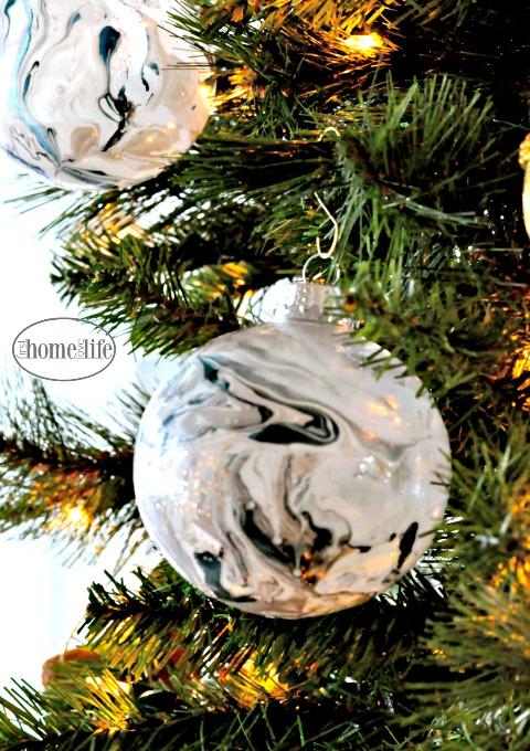 Dollar Tree DIY- Marble Ornaments using nail polish trick via firsthomelovelife.com