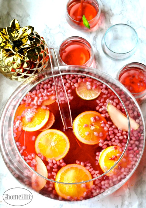 The perfect holiday punch recipe to serve at your party this year! Can easily make this non alcoholic too! (but whats the fun in that??: ;) via firsthomelovelife.com