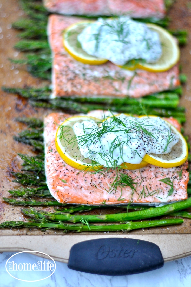 Healthy sheet pan dinner idea | Salmon with lemon and asparagus with a garlic yogurt sauce via firsthomelovelife.com