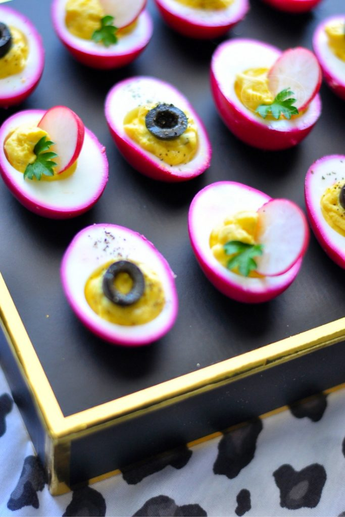 PICKLED BEET DEVILED EGGS SHOULD BE CALLED PARTY EGGS! THEY'RE HOT PINK AND DELICIOUS! GET THE RECIPE FOR THIS FUN APPETIZER AT FIRSTHOMELOVELIFE.COM