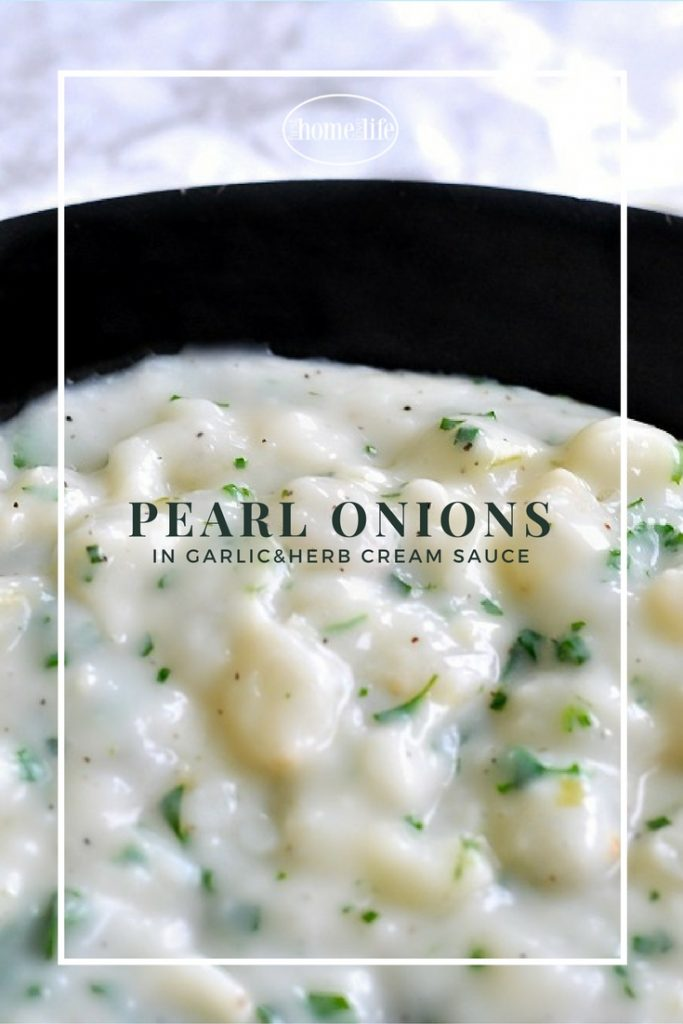 Delicious pearl onions in a creamy garlic herb sauce is the perfect side dish recipe to serve during your holiday meal! via fi