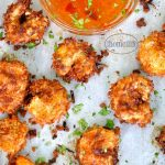 Coconut fried shrimp recipe with the perfect sweet and spicy chili apricot dipping sauce via firsthomelovelife.com