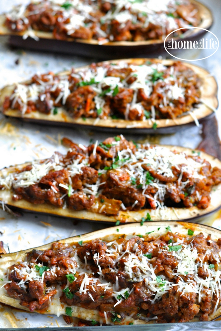 a healthier take on eggplant parmesan. These stuffed eggplant parmesan boats are overflowing with a thick and hearty ground turkey meat sauce for a low carb dinner favorite! via firsthomelovelife.com
