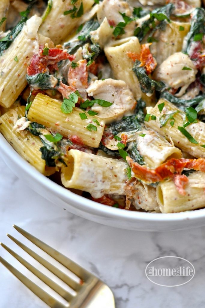 Creamy Dijon Chicken Pasta with Sun Dried Tomatoes and Spinach recipe via firsthomelovelife.com