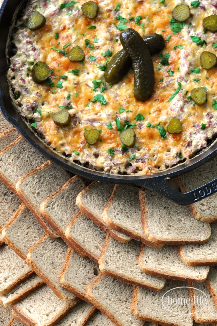 This game day favorite appetizer is the perfect party starter! Get the recipe for this Hot Roast Beef Dip served with rye bread toasts- yum! via firsthomelovelife.com